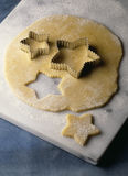 Cutting out stars in the pastry Royalty Free Stock Images