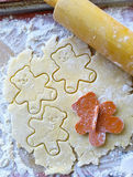 Cutting out teddy bear cookies Royalty Free Stock Image