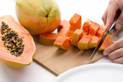 Cutting A Papaya Quarter Into Six Slices Royalty Free Stock Image