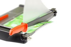Cutting paper with trimmer on white Royalty Free Stock Images
