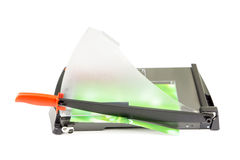 Cutting paper with trimmer on white Royalty Free Stock Photos
