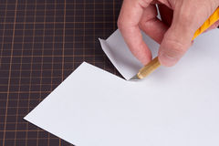 Cutting Paper with Utility Knife Stock Image