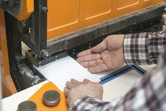 Cutting papers by guillotine machine Royalty Free Stock Photo
