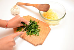 Cutting parsley Stock Photo