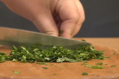 Cutting the Parsley leaves Royalty Free Stock Photography
