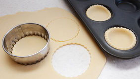 Cutting pastry circles Stock Images