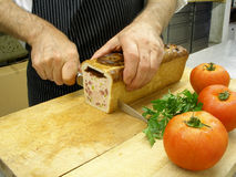 Cutting a pate in slices Stock Photo