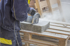 Cutting Pavings Stones 3. Cutting Pavings Stones with a grinder at construction site Royalty Free Stock Images