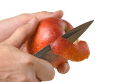 Cutting peel an apple with a knife Royalty Free Stock Photography