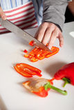 Cutting the pepper Stock Image