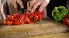 Cutting peppers stock video