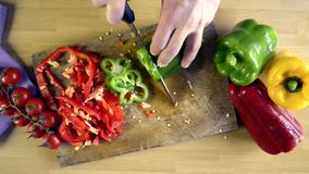 Cutting peppers view from above stock video footage