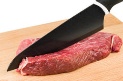 Cutting piece of beef Stock Image