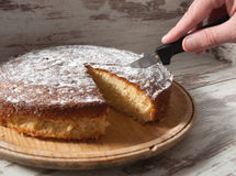 Cutting a piece of sponge cake Royalty Free Stock Photo