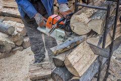 Cutting pile of wood with a chainsaw 7 Royalty Free Stock Photography