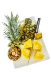 Cutting pineapple Stock Photos