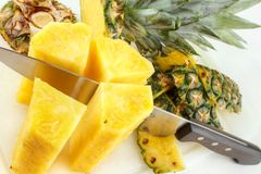 Cutting pineapple Stock Images