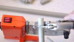 Cutting pipe with pipe shears 01 stock footage