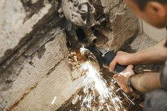 Cutting pipes , waterworks. Angle grinder , reconstruction of home concept , plumbing concept Stock Images