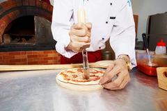 Cutting pizza Stock Image