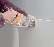 Cutting plasterboard plaster hand dirty saw royalty free stock photography