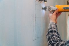 Cutting plasterboard plaster hand with electro saw