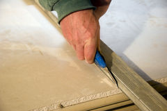 Cutting plasterboards Royalty Free Stock Images
