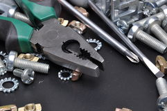 Cutting pliers tool and screws Royalty Free Stock Image