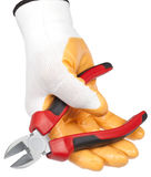 Cutting pliers and worker hand Stock Images