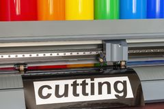 Cutting plotter close-up. The process of cutting a vinyl film royalty free stock image