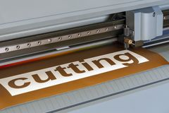 Cutting plotter close-up. The process of cutting a vinyl film stock photo