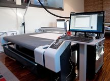 Flatbed cutter/router cutting plotter royalty free stock photography