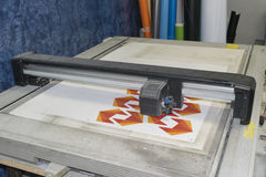 Cutting plotter in a working process royalty free stock photos