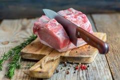 Cutting pork loin. Royalty Free Stock Photography