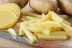 Cutting potatoes into chips Royalty Free Stock Photography