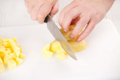 Cutting potatoes Royalty Free Stock Photography
