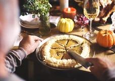 Cutting Pumpkin Pie Dessert Thanksgiving Concept royalty free stock images