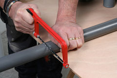 Cutting pvc pipe Royalty Free Stock Photos