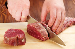 Cutting raw beef Royalty Free Stock Photos
