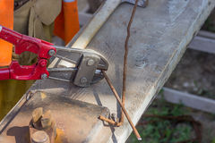 Cutting rebar with bolt cutters Stock Photography