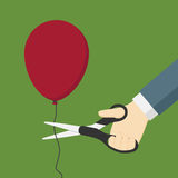 Cutting A Red Balloon with Scissor. Hand Holding Scissor And Cutting A Red Balloon Stock Image