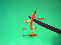 Cutting a red chilly pepper Stock Photo