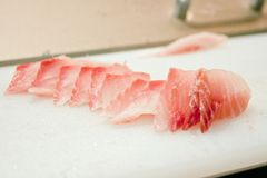 Cutting red fish knife Royalty Free Stock Photo
