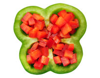 Cutting red and green bell peppers Stock Images