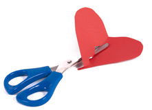 Cutting a red heart. In half on white background Royalty Free Stock Photos