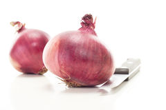 Cutting red onions for salad Royalty Free Stock Photography