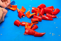 Cutting red pepper Stock Image