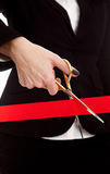 Cutting a red ribbon Royalty Free Stock Photos