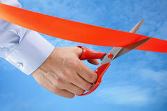 Cutting a red ribbon Stock Photography