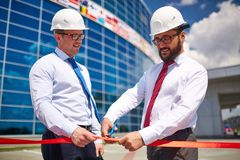 Cutting red ribbon Royalty Free Stock Image